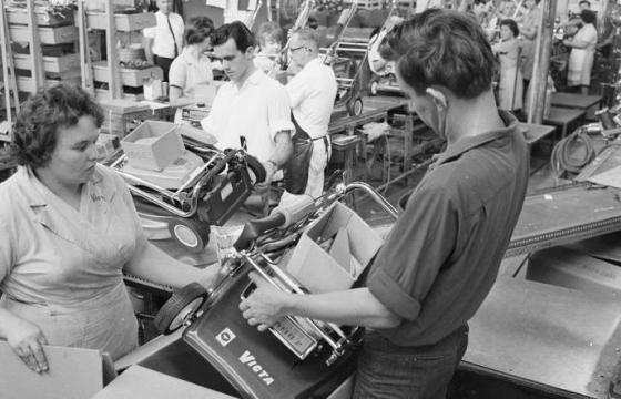 Workers at Victa Mowers on the production line